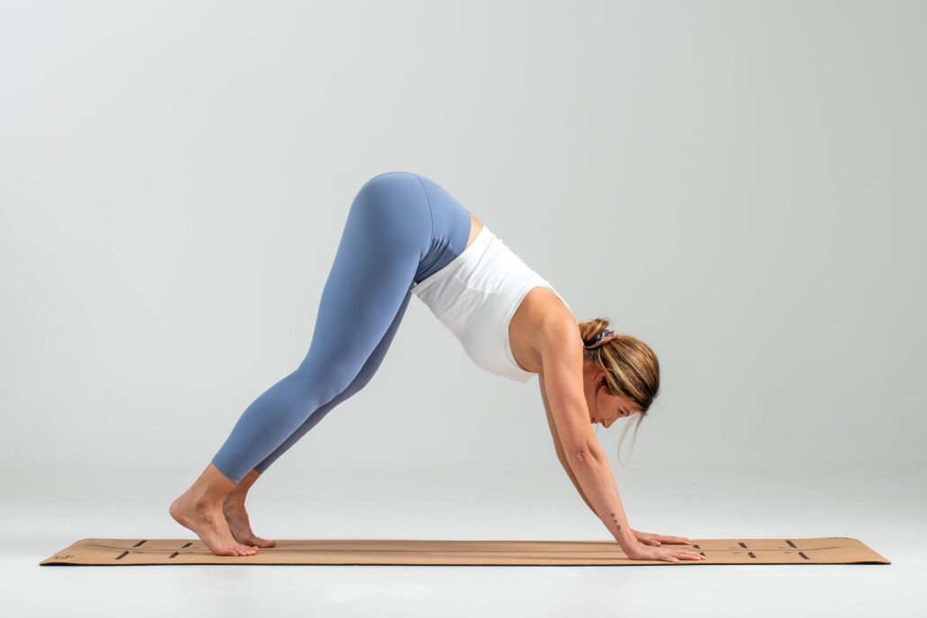 Lifting the head and look forward during Downward Dog compacts the vertebrae of the back of the neck