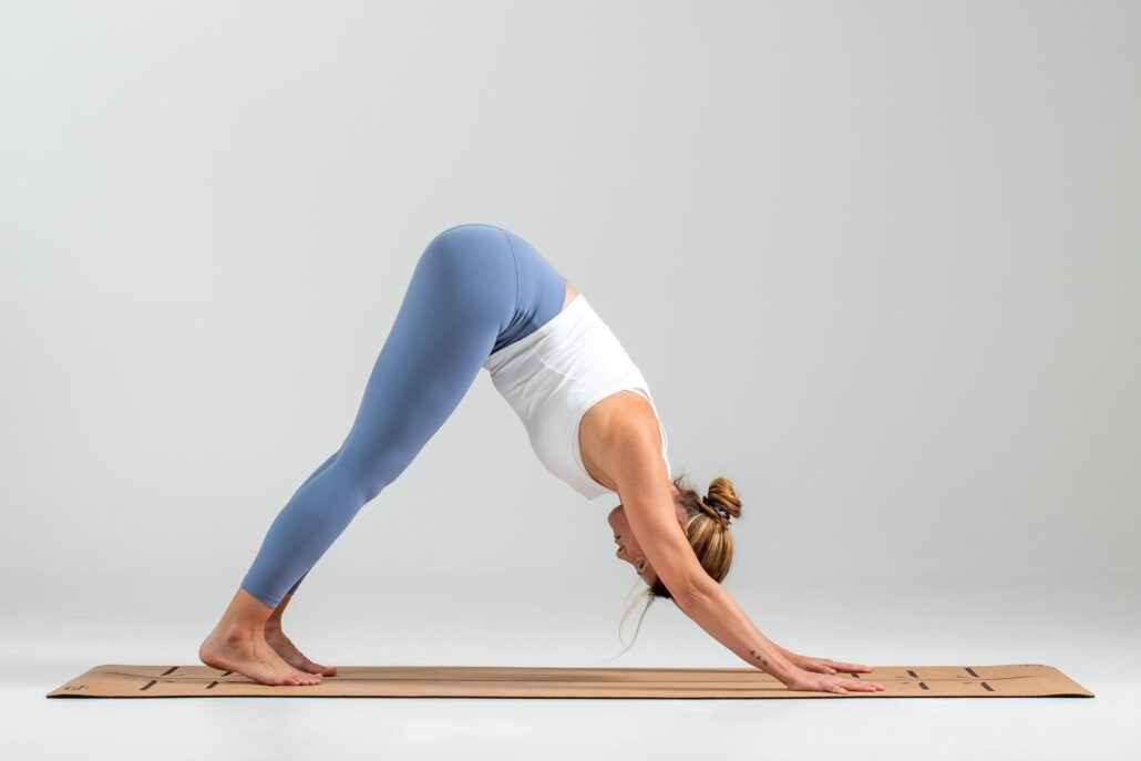 Plank pose requires a flat body elevated on straight arms with flat palms and curled toes